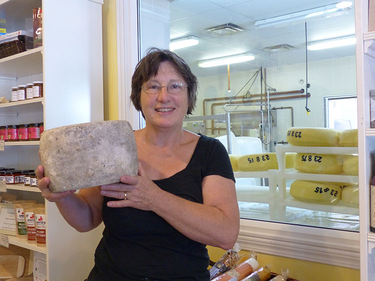 Debra Amrein-Boyes, cheese maker and co-owner of The Farm House Natural Cheeses, with her award-winning traditional Clothbound Cheddar