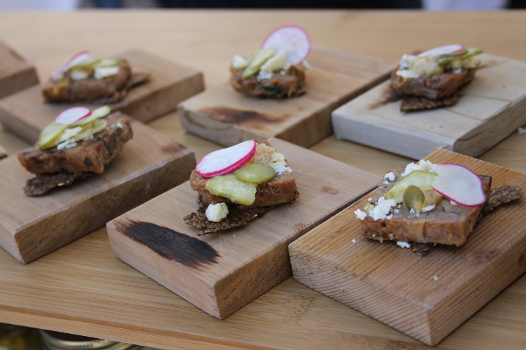 Head Cheese Rillettes sourced from the pigs at Urban Digs Farm on a flax cracker with beer mustard, pickled Klippers Organics cucumbers, and Qualicum blue cheese.