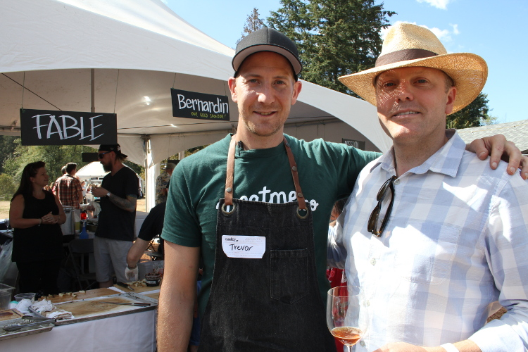 Scapillati (right) in a well-suited straw hat talks with Canadian celebrity chef Trevor Bird of Vancouver's Fable (Farm to Table) restaurant.