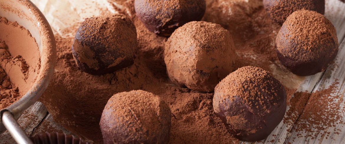 chocolate truffles sprinkled with cocoa powder close-up