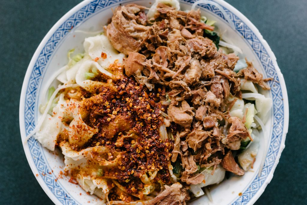 Noodles with fried pork and chili at Richmond Public Market, Canada