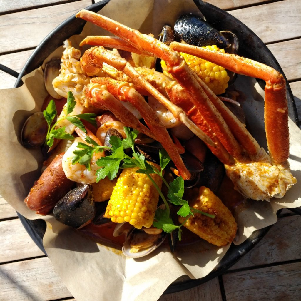 Louisiana clambake share platter. | Photo: Blue Canoe Waterfront Restaurant